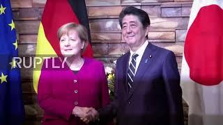 Japan: Abe and Merkel pledge to bolster cooperation at Tokyo talks