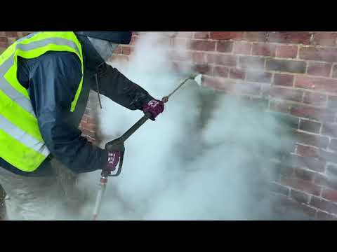 Doff steam cleaning / Doff brick cleaning removing algae and organic matter from historic brickwork