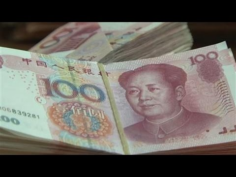Chinese Yuan Hits Lowest Level in Almost 8 Years