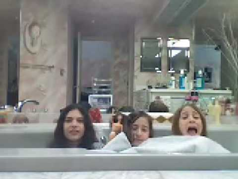 Little kids taking a bath