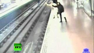 CCTV Drama: Man falls on rails, pulled out in front of moving train