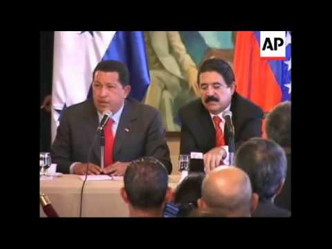 Venezuelan President Chavez arrives for a meeting with President Zelaya