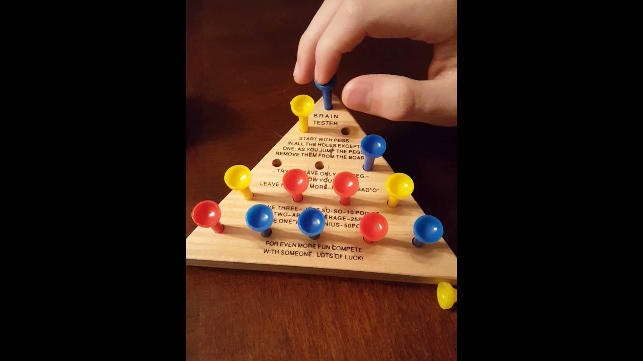 Trick To Beating The Triangle Peg Game How To Youtube
