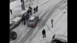 Gambar cover MAN Stops CAR Sliding On SNOW.