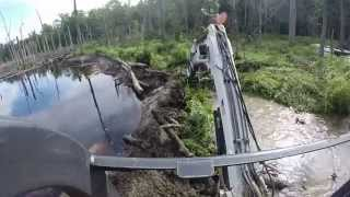 Busting A Beaver Dam!  Mini Bobcat Excavator Mud Stuck Water Creek