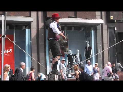 Playing violin on tightrope
