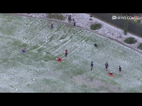 Watch: Kids in Goodyear are sledding through the hail