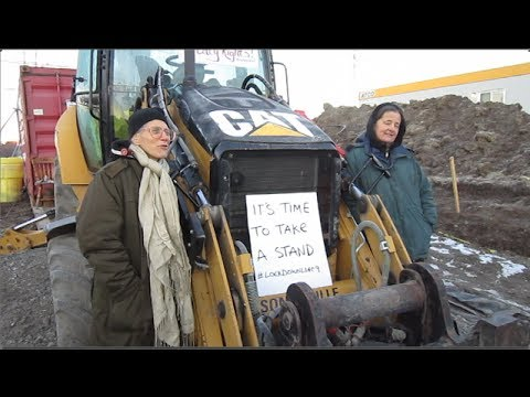 Ontario Activists Protest Tar Sands Pipeline By Locking Themselves to Machinery