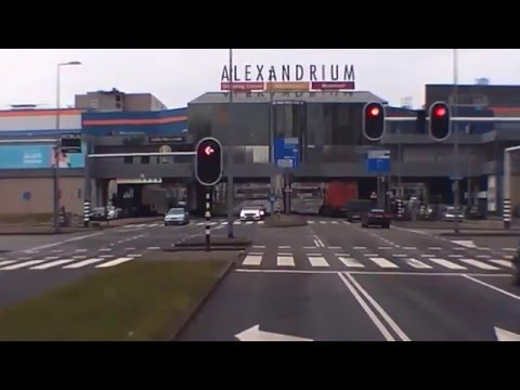 Holland:Rotterdam,Train passing near Alexandrium Center