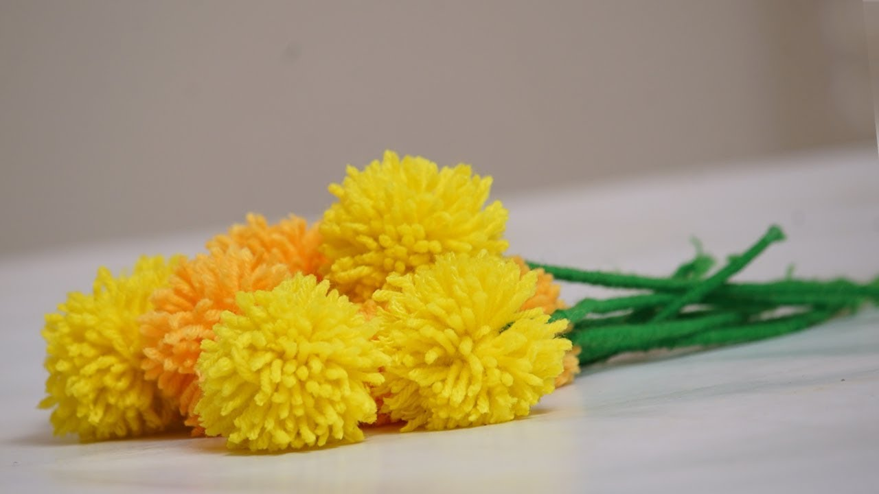 Diycrafts make a woolen marigold flower diy pom pom flowers woll diycrafts make a woolen marigold flower diy pom pom flowers woll flowers home decor mightylinksfo