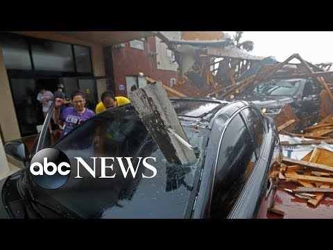 Doc Reno - Hurricane Michael rips roofs off buildings as it strikes Florida