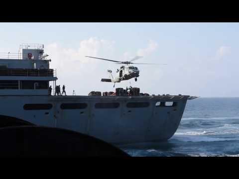 USS George H.W. Bush takes on ammunition.