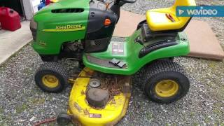 Changing blades and deck belt on John Deere riding mower.
