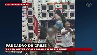 Baixar Traficantes ostentam armas em baile funk