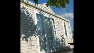 Les mobil-homes du Camping La Rotonde-Le Village Western (Hourtin)