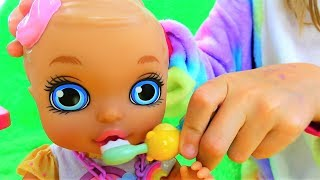 The doll eats and brushes its teeth. Polina as a mom for a baby