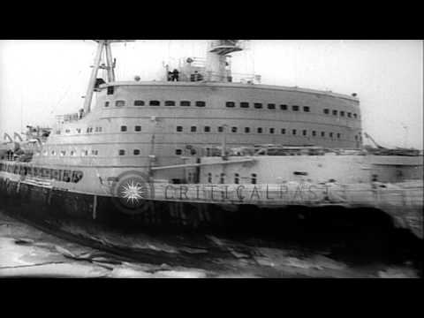 Russia's atom powered icebreaker brings supplies and equipment to Arctic. HD Stock Footage