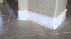 Does baseboard get installed before or after a tile floor?