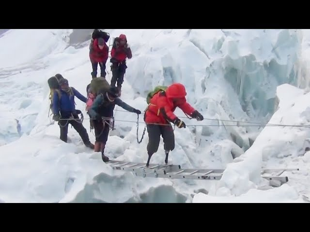 Impossible Challenge: Chinese double amputee makes fifth attempt at Mount Qomolangma