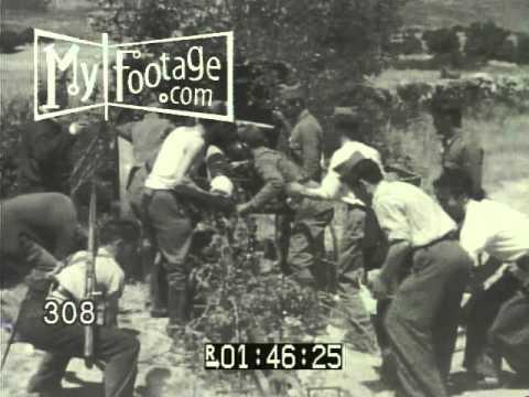 1936 SPAIN: BATTLE FOR MADRID. REBEL TROOPS ASSAULT CAPITAL. MACHINE GUNS