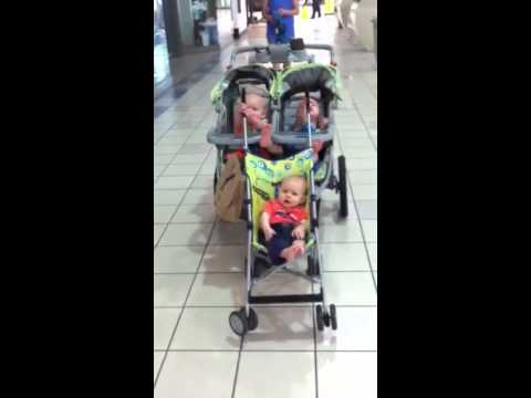Twins turn double stroller into triple stroller and push li - YouTube