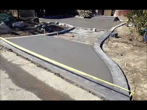 Concrete driveway pouring process march 2014 youtube for How much does it cost to have a foundation poured