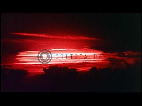 Orange glow and mushroom cloud of nuclear test Cherokee at Bikini Atoll ...HD Stock Footage