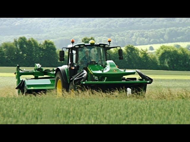 Prezentacja nowej serii 6M podczas pokosu trawy | John Deere