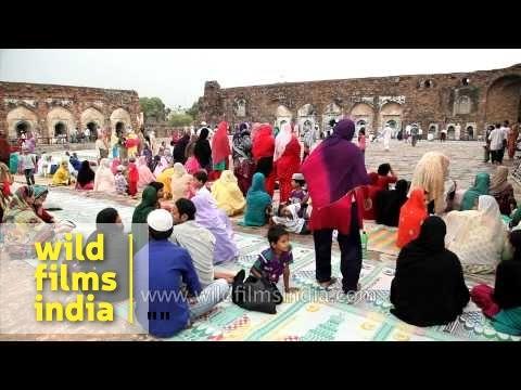 Women offer prayer amongst the ruins of  Feroz Shah Kotla Fort