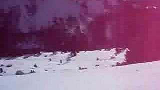 Snowboard ride down black slope in Selva, Val Gardena