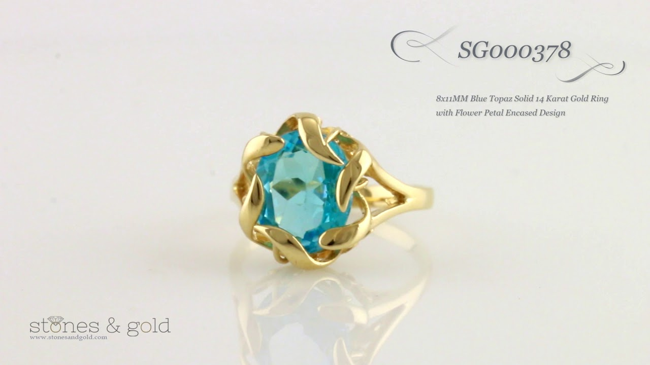 8x11mm blue topaz solid 14 karat gold ring with flower petal encased design sg000378