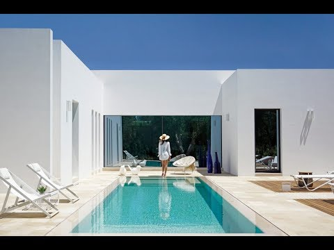 Minimalist Modern Home with Facade of the previous 50's House