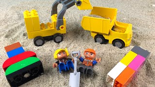 Lego Duplo Construction Toys Treasure Hunt in the sand with the Mighty Machines Loaders Dump Truck