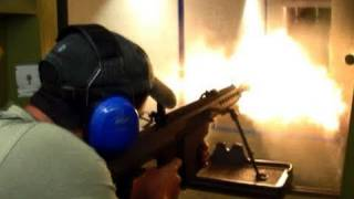 50 caliber Barrett fired by several different people, indoors, short barrel
