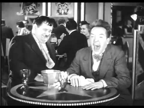 Image result for uncontrollable laughter laurel and hardy gif