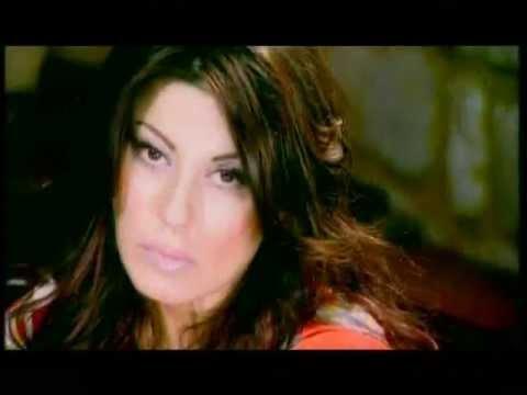 Angela Dimitriou - Mualo mou epikinnduno (Official Clip) + Lyrics