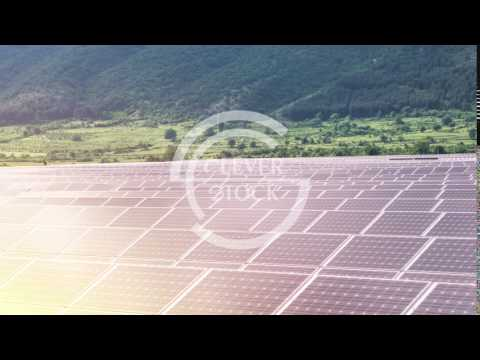 Renewable Energy Electricity Solar Panels Farm Field In The Mountains Beautiful Sunset Nature
