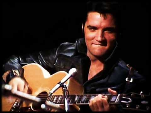 elvis presley playing guitar