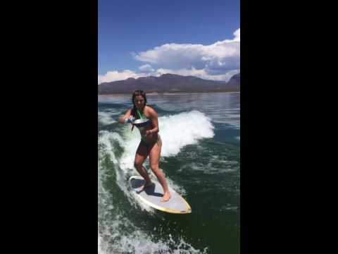 Beer bong on the wake surf
