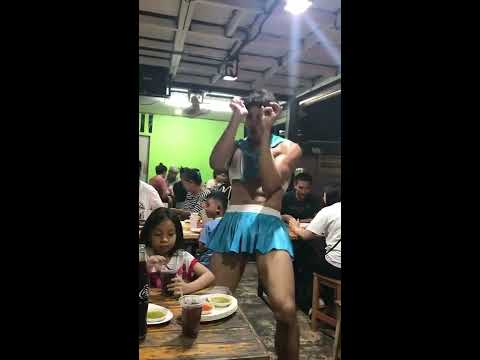 Thai restaurant with male waiters in tight female uniforms Dancing and Serving Customers