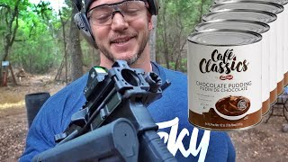 BIG Man Shoots Weird Guns at GALLONS of Pudding...