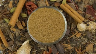 Traditional raw spices with a bowl of garam masala powder - the healthy spice of India