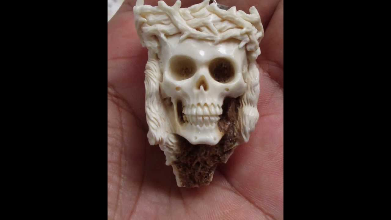 Yesus skull carving pendant in antler with sterling silver