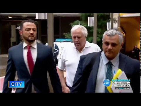 Clive Palmer has arrived in court with a pillow and a vomit bag
