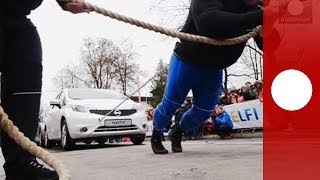 Strongman record: Man pulls 12 cars with rope attached to waist in Lithuania