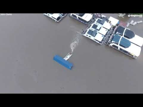 Skipper Uses Boat to Stop Runaway Container Crashing Into Houseboats || Dogtooth Media