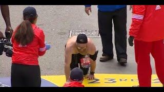 Marine crawls across Boston Marathon finish line to honor fallen comrades