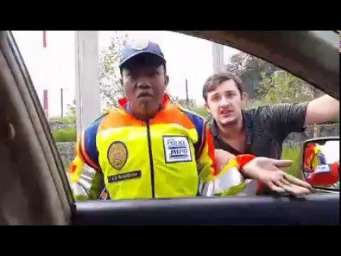 Johannesburg Metro police assault motorist