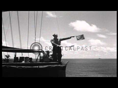 US transports, destroyer escort, and LST (Landing Ship, Tank) underway during Wor...HD Stock Footage