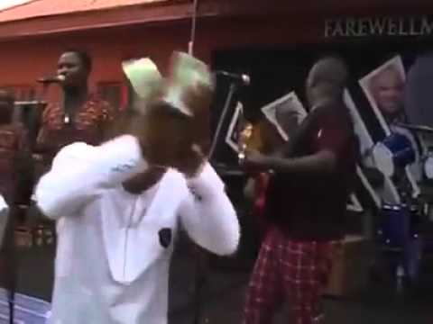 Ex Nimasa DG spraying bundles of dollars.